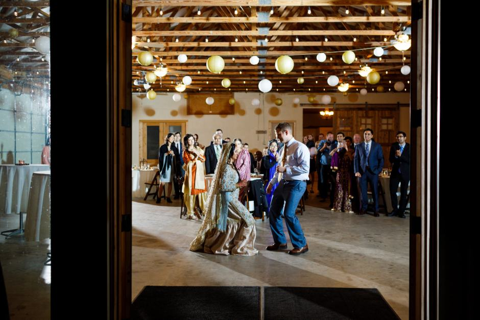 Bride and groom enjoy a first dance during their Heart of Texas Ranch Wedding reception in Marble Falls Texas - Indian-Christian Fusion Wedding