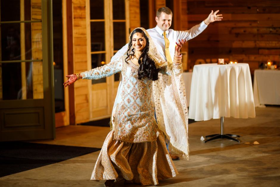Bride and groom make their entrance during their Heart of Texas Ranch Wedding reception in Marble Falls Texas - Indian-Christian Fusion Wedding