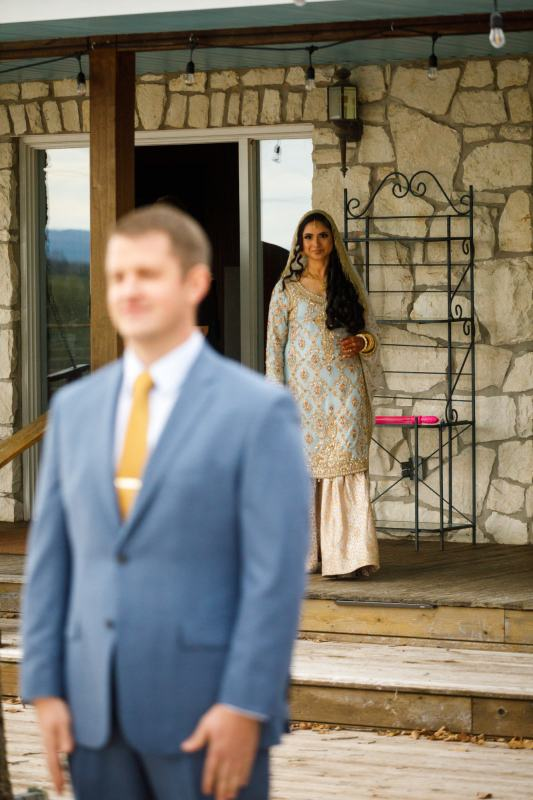 Bride walks towards the groom during their first look - Jay and Samira - Heart of Texas Ranch Wedding in Marble Falls Texas - Indian-Christian Fusion Wedding