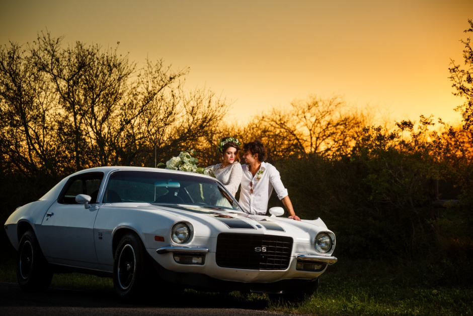 Austin Wedding Styled - Styled Elopement - Bride and Groom pose next to their classic camaro get-away vehicle.