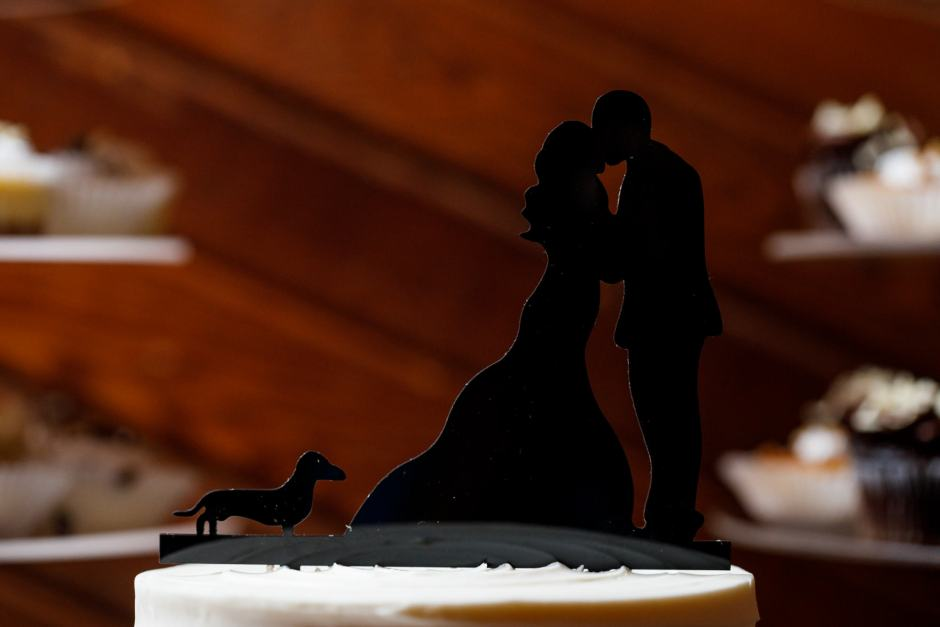 A Dachshund wedding topper at a Ruby Ranch Lodge wedding reception in Buda, Texas.