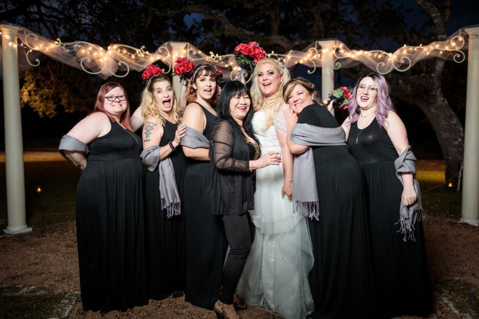 The Bride and Bridesmaids under pretty lights at Ruby Ranch and Lodge in Buda, TX.