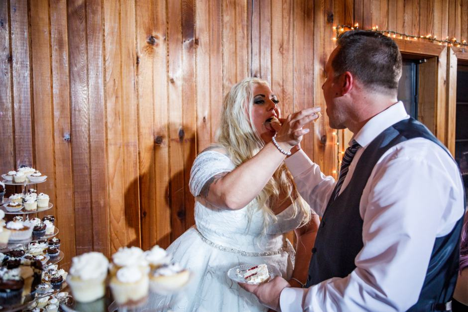 Bride and Groom cut the cake at their Buda wedding reception at Ruby Lodge and Ranch near Austin, Tx.