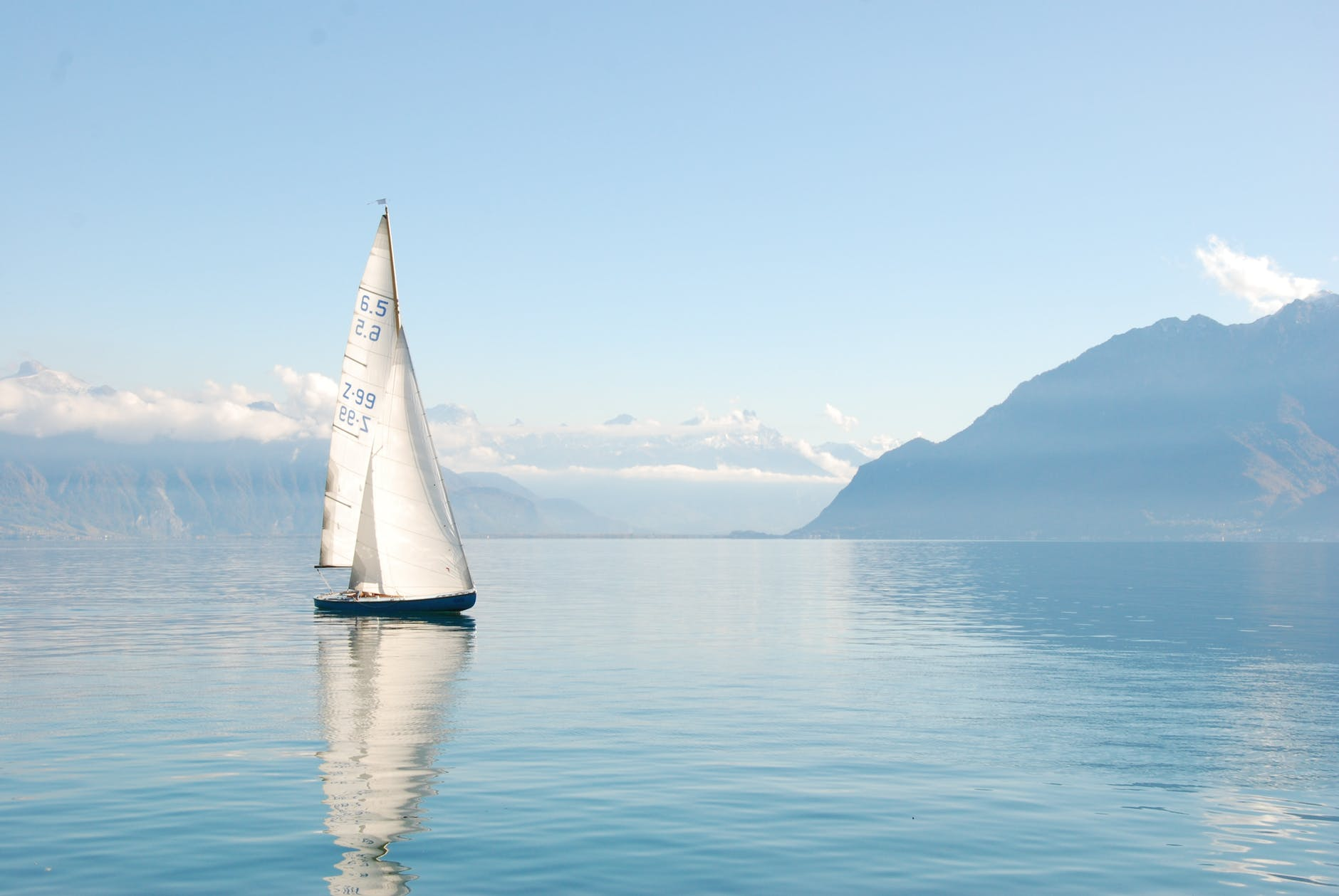 white sailboat on water