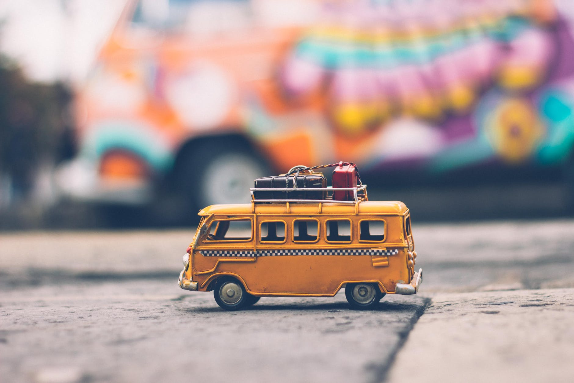 selective focus photography of yellow school bus die cast