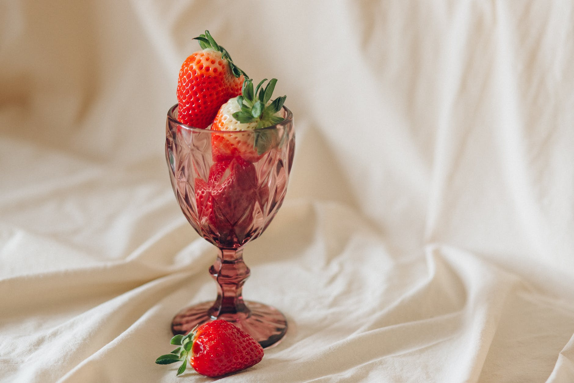 red strawberry in wine glass