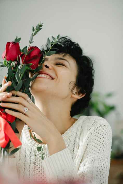 joyful woman with bouquet of roses