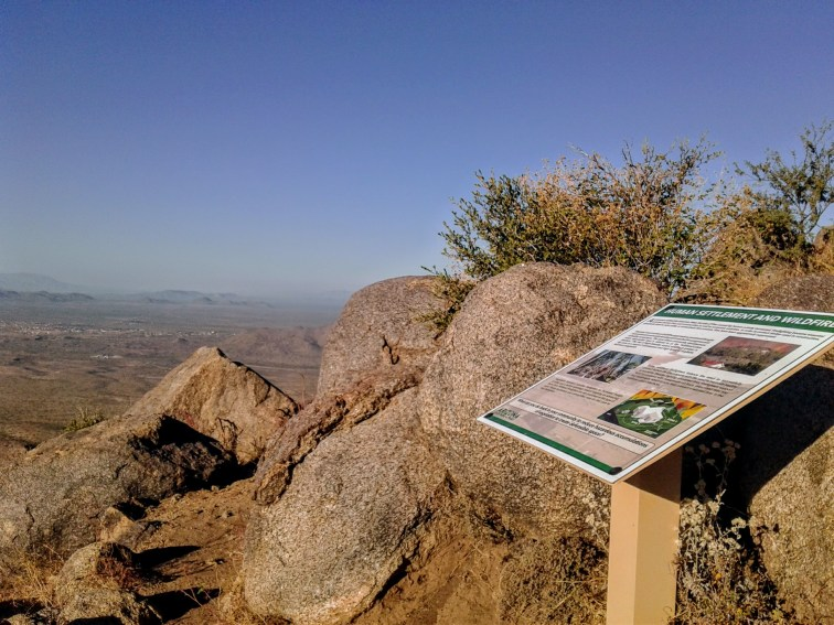 Interpretive sign and scenic view along Granite Mountain Hotshots Trail