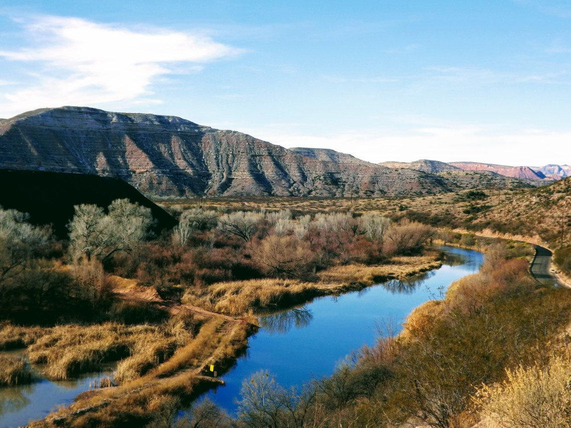 Suspended view of Arizona's Verde River with towering canyon wall in background