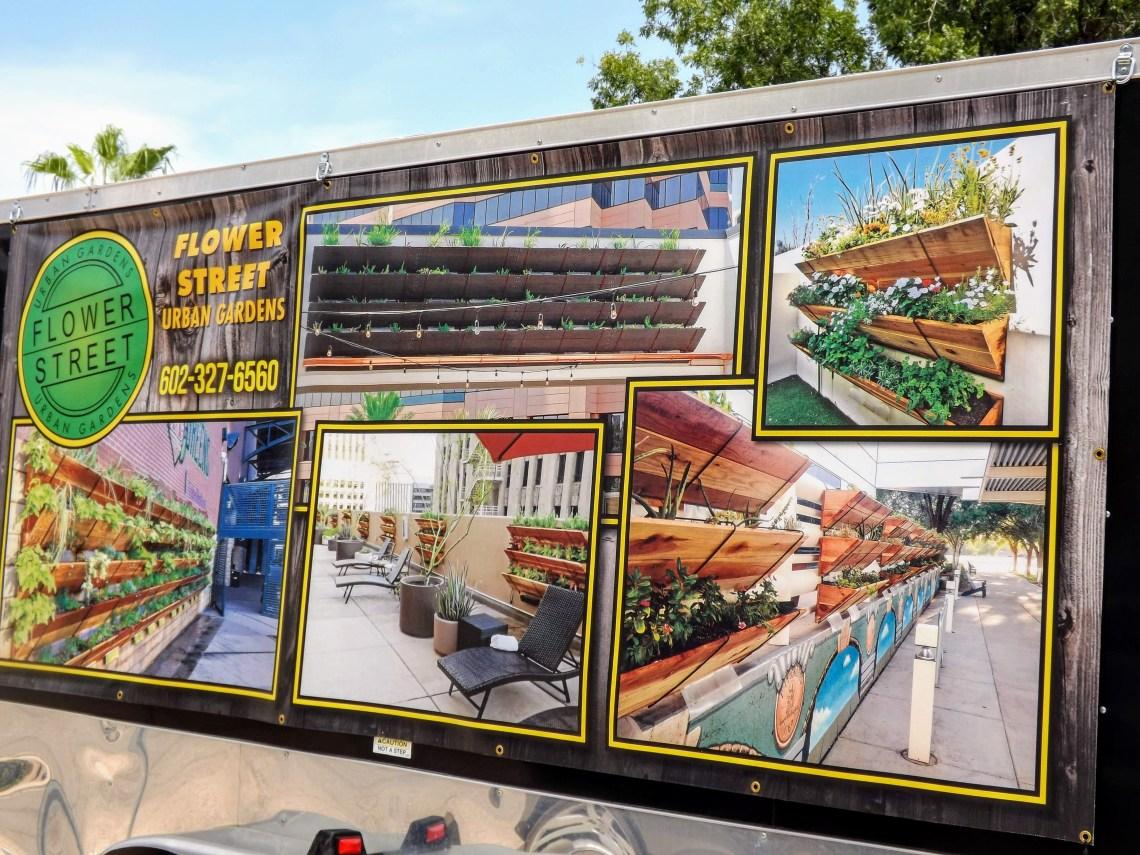 Trailer with banner showing vertical garden installations