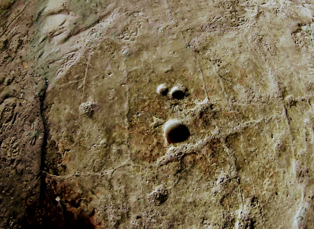 Three small holes drilled in stone floor