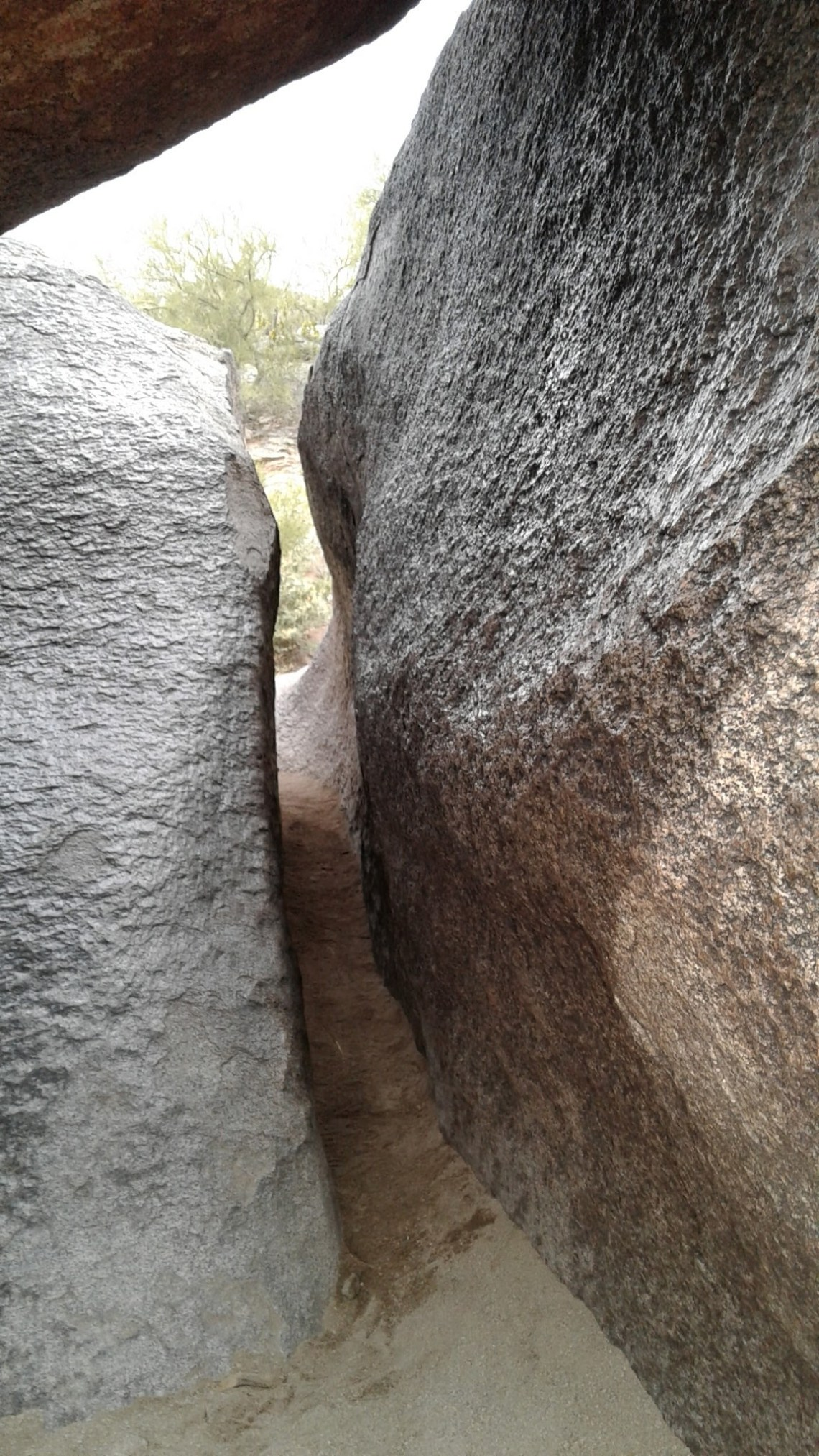 tight space between two boulders
