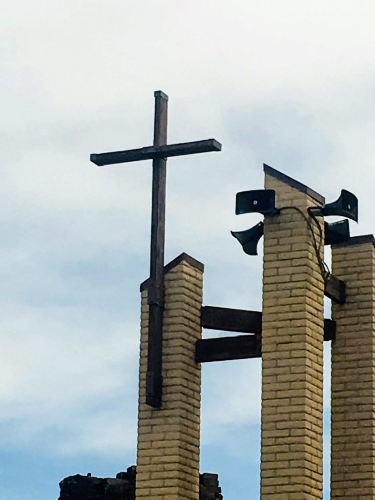 Cross at St. Joseph Church survives devastating fire.
