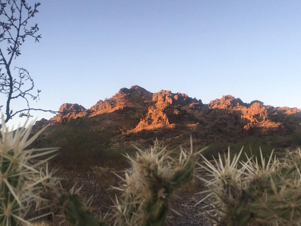 mountain in desert lit up by sun