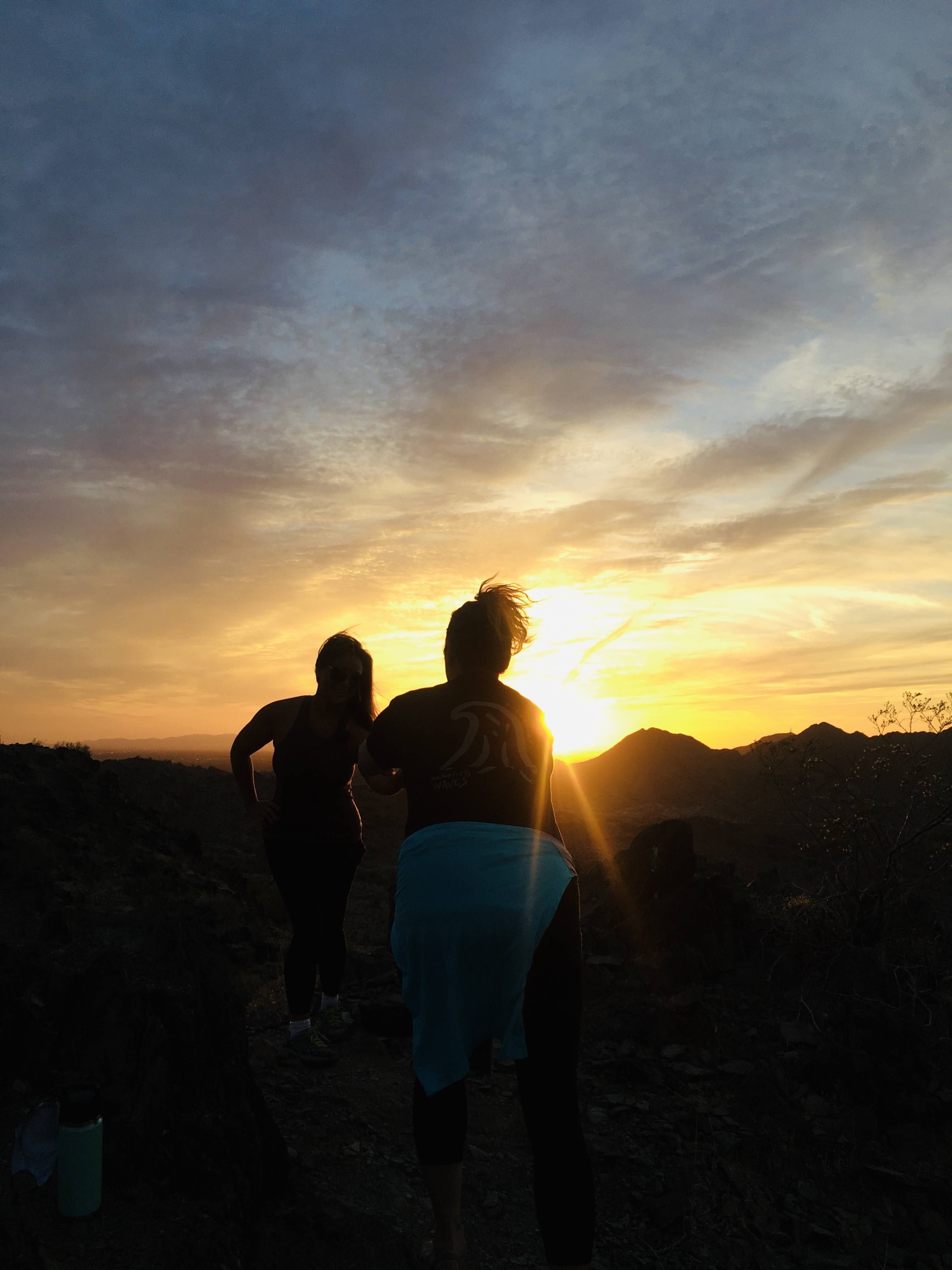 Guided hike participants admire sunset from Phoenix Mountains Preserve