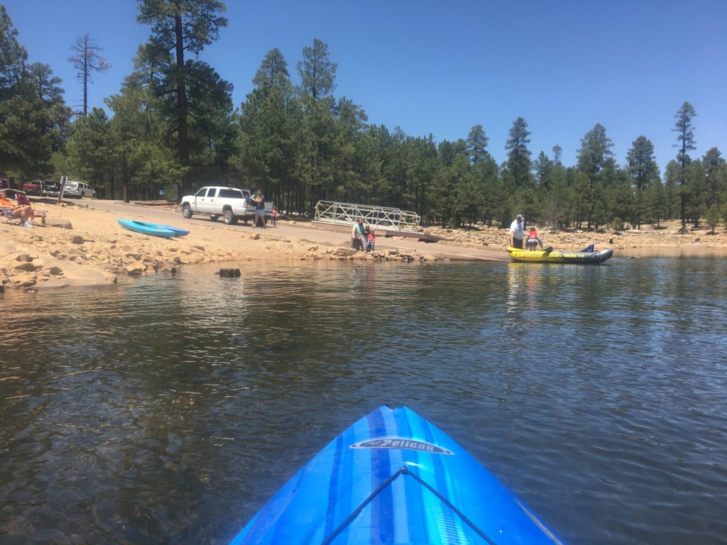 View of Willow Springs Lake boat ramp from a kayak on the water