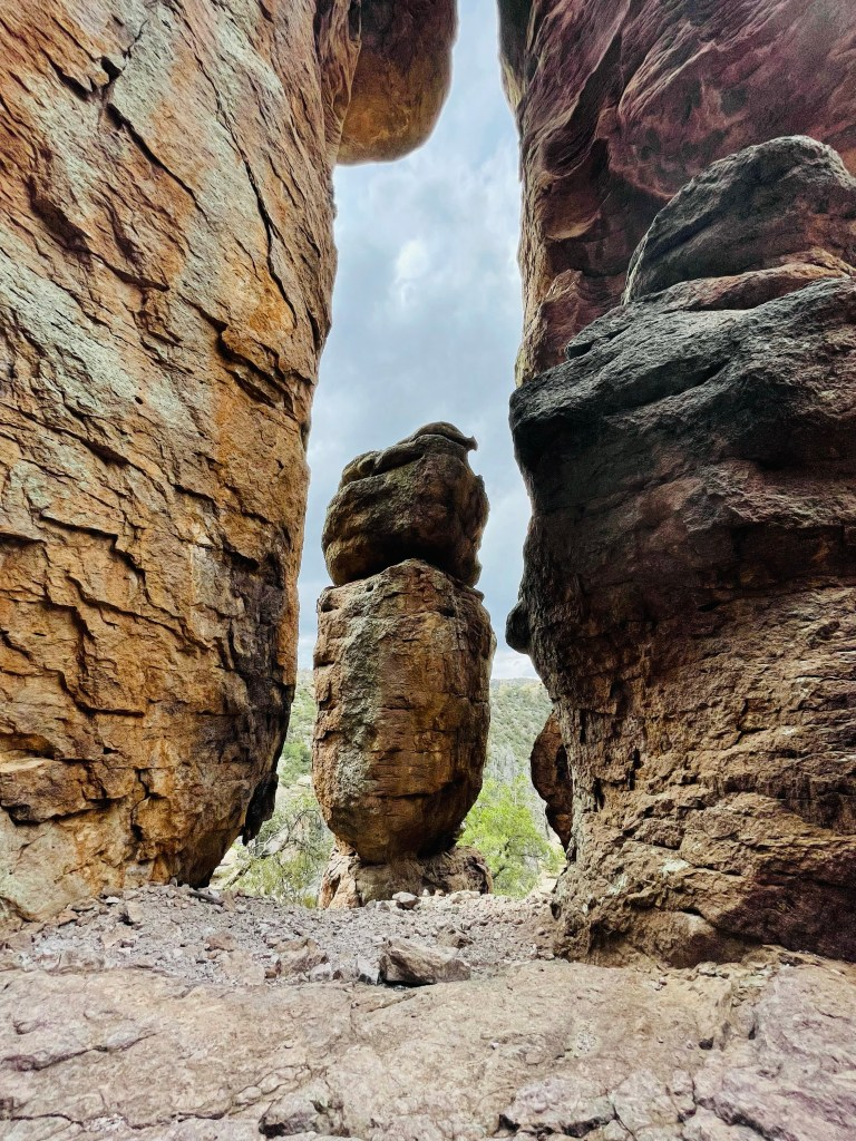 columns of rock rise up from trail