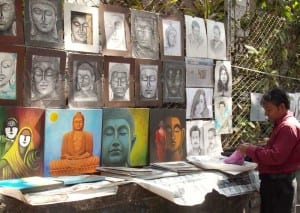 Artist selling Buddha paintings.