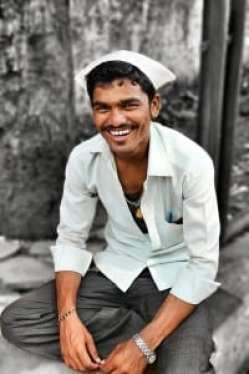 Mission Accomplished! Job satisfaction radiates from every Dabbawala's smile. Photo courtesy: Aditya Chichkar.