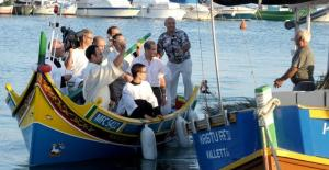 Marsaxlokk's parish priest blesses the fishing fleet before the season starts.