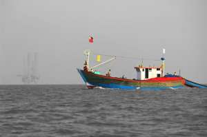 Fishermen returning home with their catch