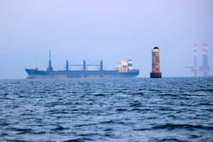 Sunk Rock Lighthouse directing the ships beyond the oil rigs at Mumbai Harbour