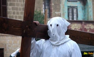 Penitents and those with vows in Good Friday procession - a tradition inherited from Spain