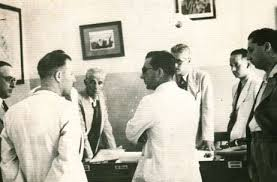 Young architect Dom Mintoff (centre) planning to destroy the slums.