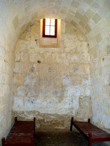 A sparse and gaunt prison cell at Vittoriosa Palace