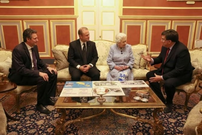 Queen Elizabeth chatting to Barts Hospital CEO Anthony Warrants (right) about Barts plans to manage the Gozo General Hospital.