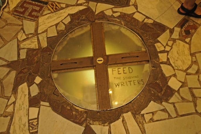 The Starving Writers money box fixed in the floor of the Shakespeare & Co bookshop