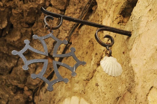The shell, symbol of Compostelle pilgrims, and the Occitane cross