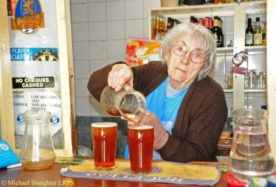 Bessie-pouring-beerfrom-a-jug