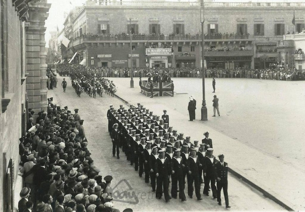 A grand military parade in the early 50s marching past the then British Governor's Office and St George's Square, now Palace Square.