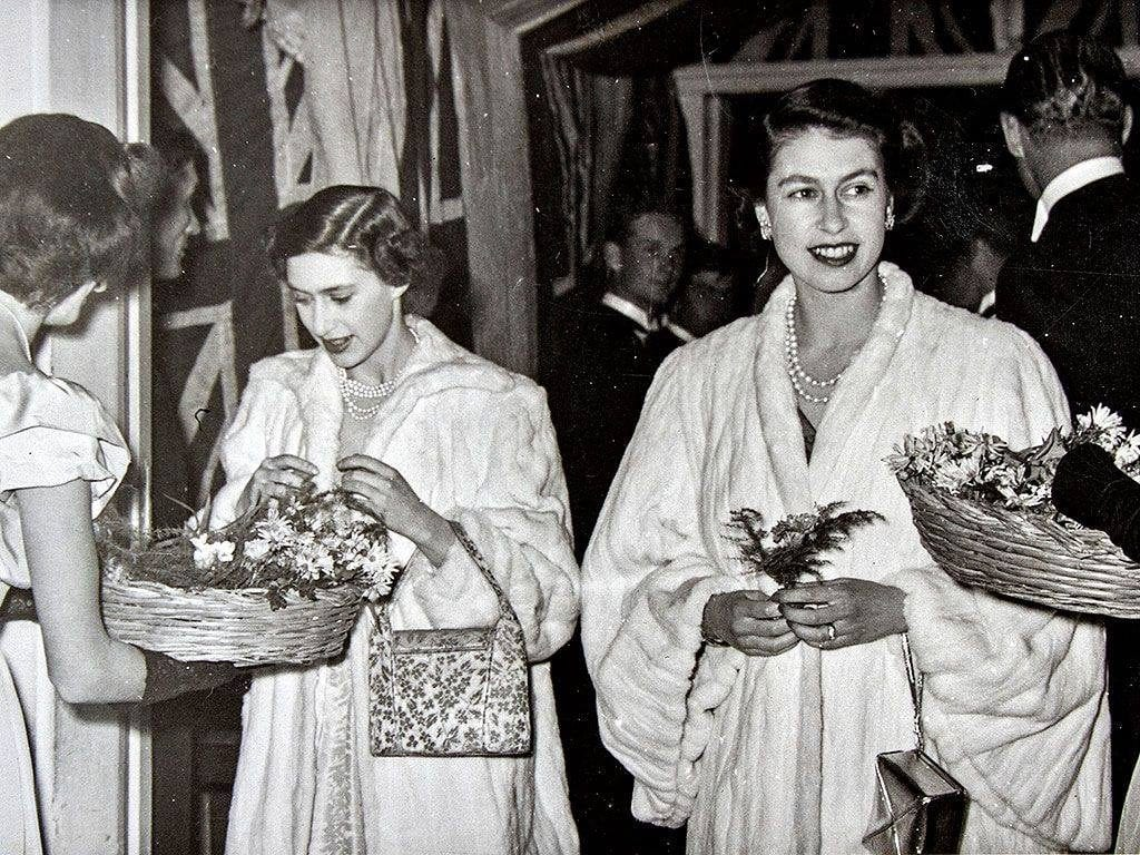 Princesses Margaret and Elizabeth (with Prince Philip behind her) entering the elite Sliema Union Club in 1950.