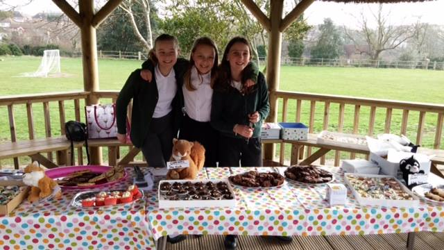 Girls raise money for WRAS with a Cake Sale