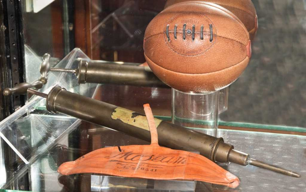 Pic An early Gilbert ball with an Indian rubber bladder and pump
