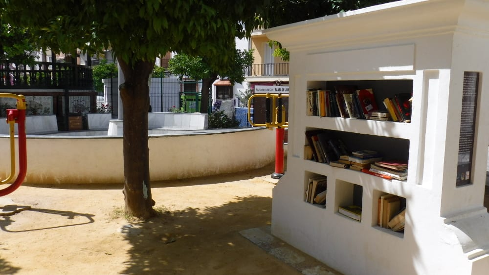 Pic Too hot to play then sit in the shade and read a book