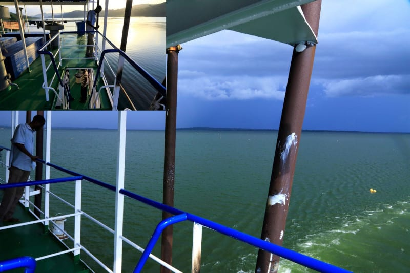 Storm on the southern horizon over Lake Volta Passenger on upper deck in the evening