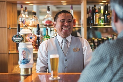Barman serving drink on Braemar