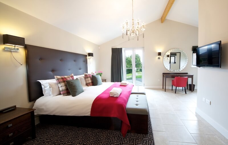 One of the Lodge Penthouse bedrooms at Stoke by Nayland Hotel Country Lodges copy