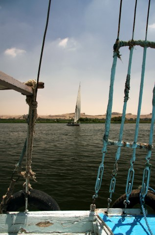 Felucca on the Nile framed by the rigging of another