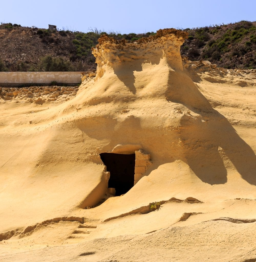 MalDia Soft limestone rocks easily hewn providing shelter from scorching sun for the harvesters
