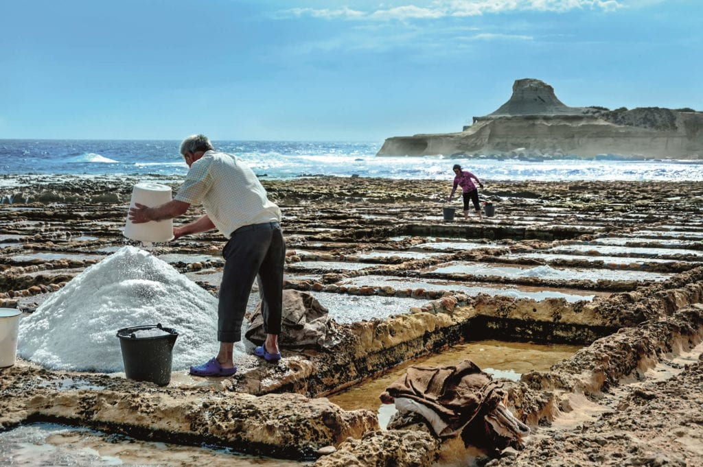 MalDia Collecting the saline crystals at Xwejni in Gozo