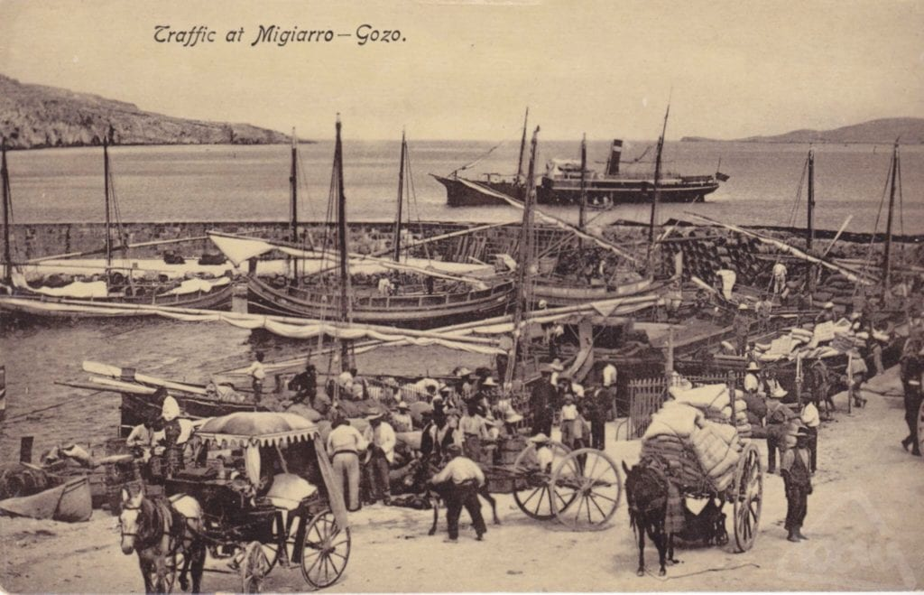 MalDia Mgarr Harbour in Gozo at the turn of the th and th Centuries teeming with luzzus horses donkeys and carts and of course people