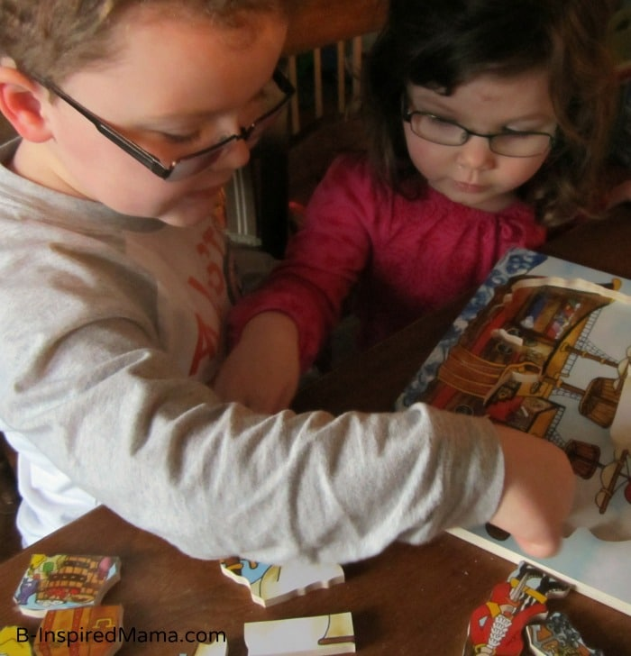 Playing with our Flipzle Wooden Puzzle at B-InspiredMama.com