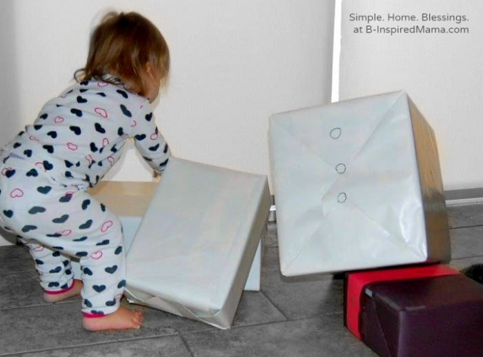 Toddler Playing with A Cardboard Box Snowman Play Set at B-Inspired Mama