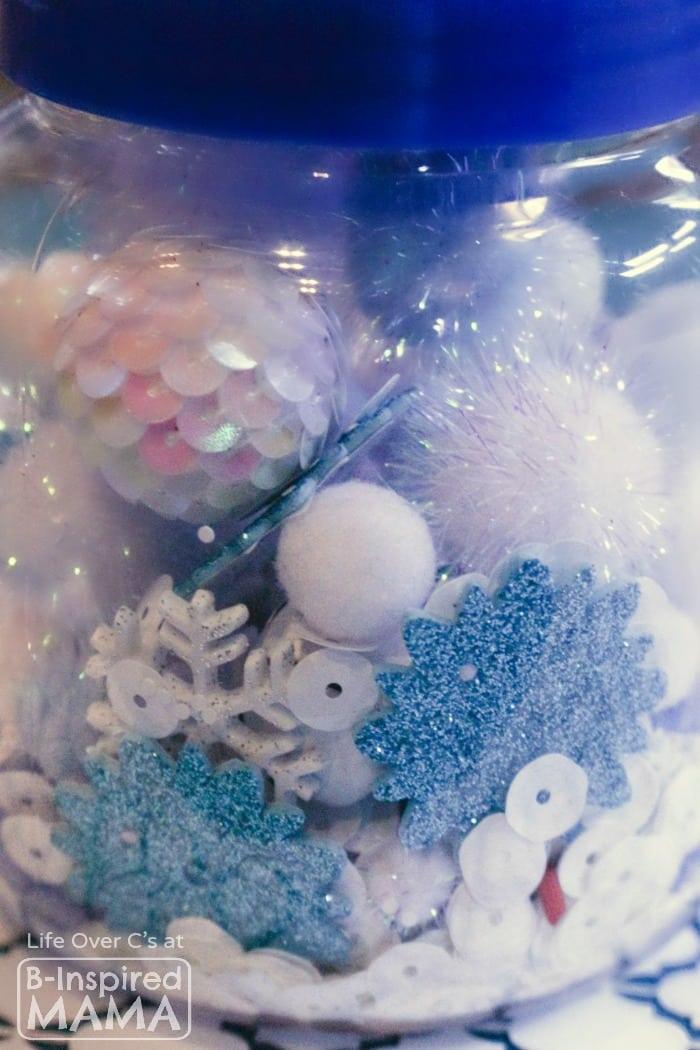 Easy DIY Toys - A Simple Snowflake I Spy Jar - B-Inspired Mama