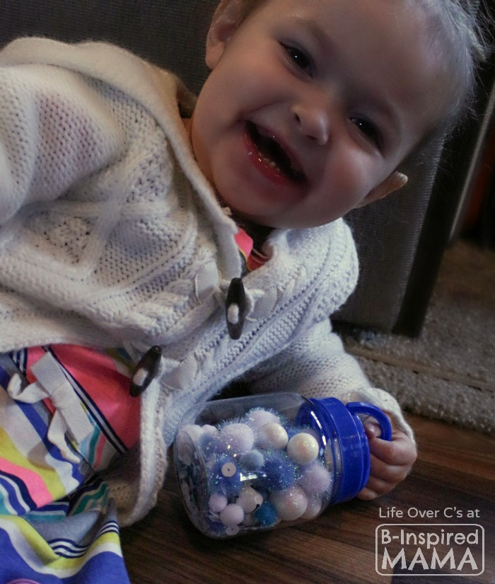 Easy DIY Toys - Playing with a Snowflake I Spy Jar - B-Inspired Mama
