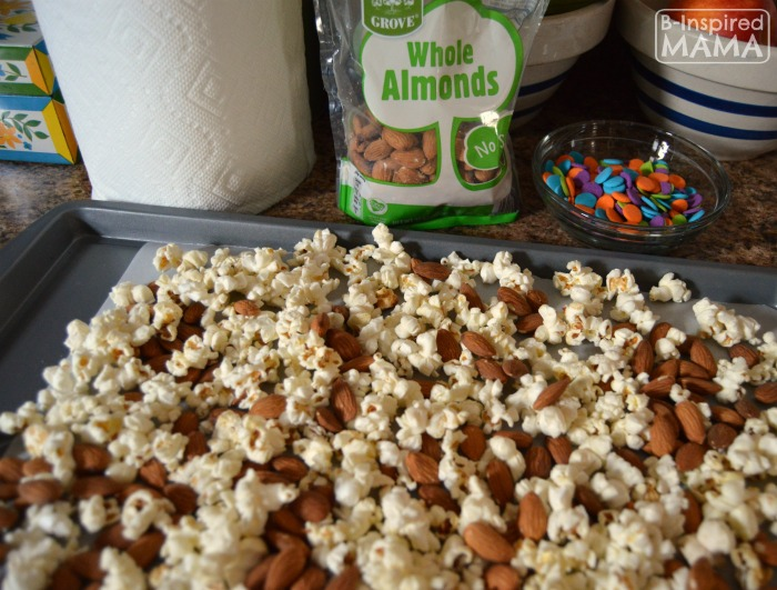 Making Some Neon Slime Popcorn Snack Mix for Watching the Nickelodeon Kids Choice Awards at B-Inspired Mama